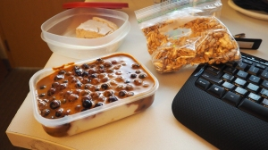 Greek yogurt, blueberries, MTS Whey, PB2 and some Walden's Farms. Bag of puffed kamut and a slice of PB&J cheesecake.