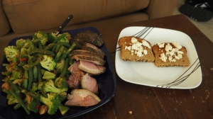 Sous Vide leg of lamb with Asian veggies and two slices of bread with reduced fat feta cheese.